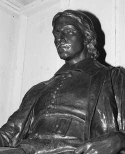 Mustachioed John Harvard statue