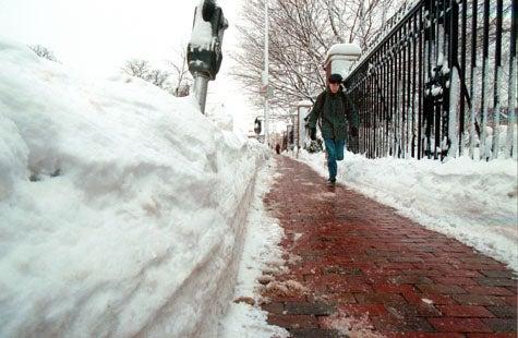 Parking meter buried in snow