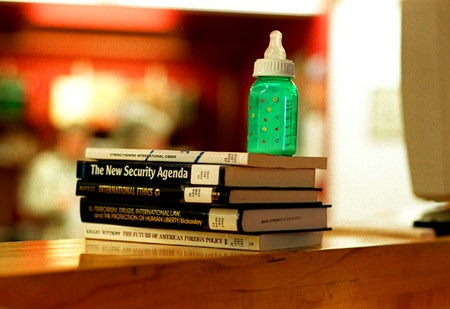Baby bottle and books