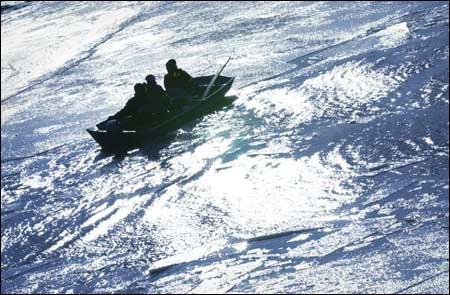 Rowers on the frigid Charles