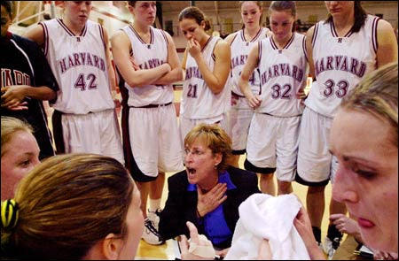 Coach exhorting her team