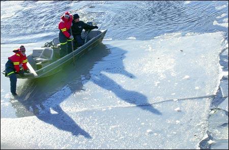 Crew half on the ice, half on water