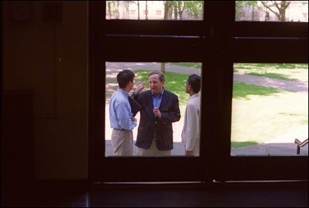 Lawrence H. Summers with Harvard staff