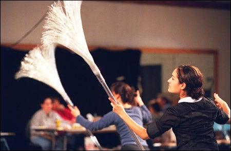 dancers with brooms