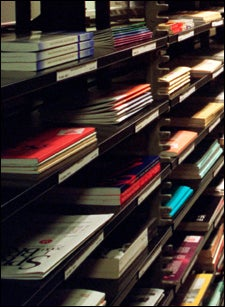 photograph of journals on library shelves