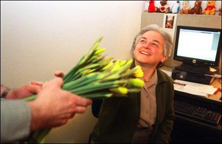 Joyce Guarnieri receiving daffodils