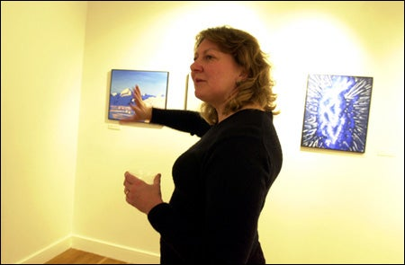 Sandra Chapman with her paintings