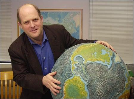 Schrag holding globe