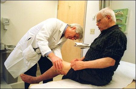 Scadden with patient