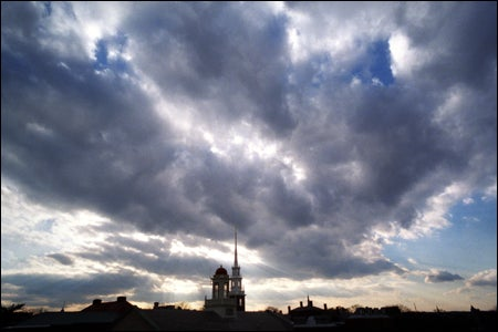 dramatic sky over Memorial Church and Cambridge Fire Dept. tower