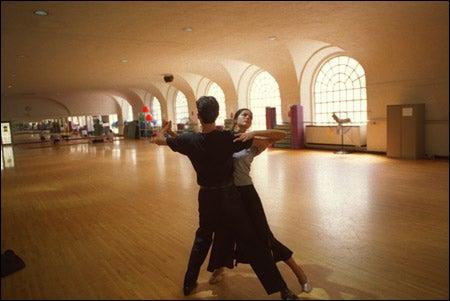 Gamze Dinckok '04 and Ryan Brown '04 practice their ballroom dance routine at the MAC.
