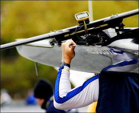 Rower shouldering his boat