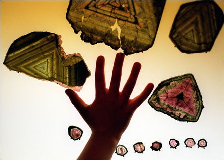 child's backlit hand with tourmaline