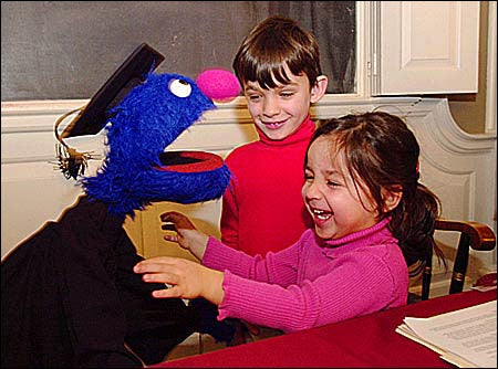 Grover with young students