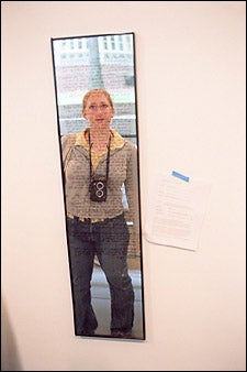 student in mirror