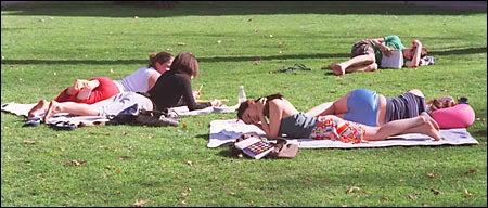 students sunbathing