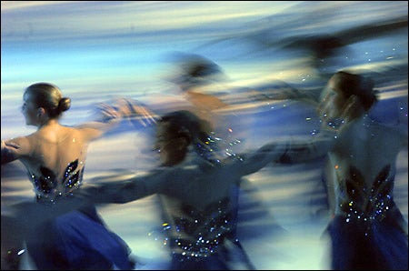 skaters with glittering costumes