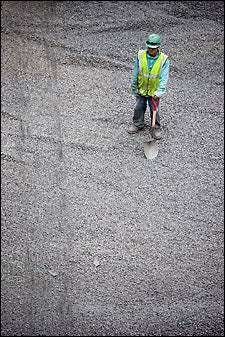 contractor with shovel