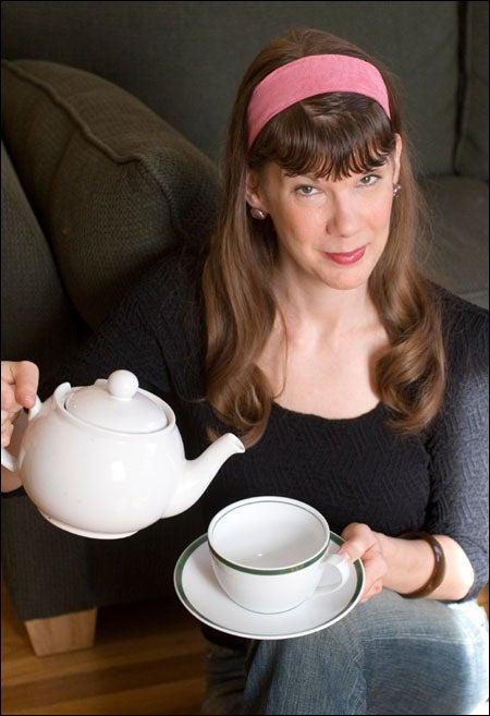 Miss Conduct pours tea