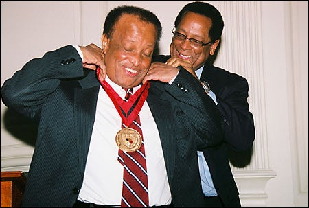 Carrington is presented with medal