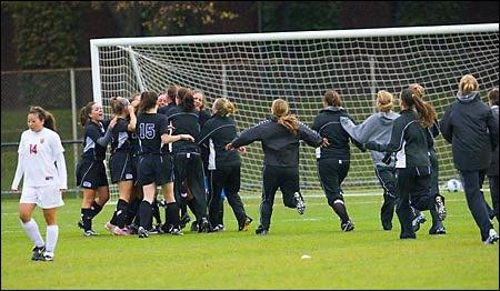 Winning team crowd the goal