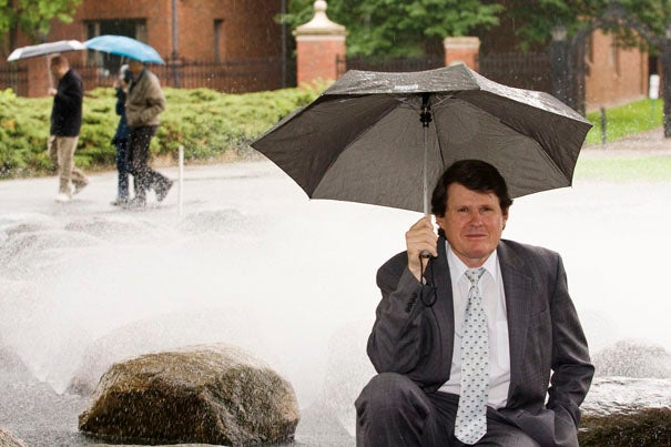 (Cambridge, MA - May 29, 2009) - John Briscoe, Gordon McKay Professor of the Practice of Environmental Engineering in the School of Engineering and Applied Sciences and Professor of the Practice of Environmental Health (School of Public Health); Professor of the Practice of Environmental Health, stands surrounded by water outside the Science Center at Harvard University. John Briscoe's career has focused on the issues of water and economic development, and most recently  he served as the World Bank's Senior Water Advisor. Staff photo Jon Chase/Harvard News Office