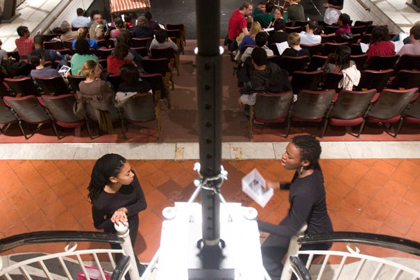 Ushers Julienne Coleman '11 and Lindsey Ross '11 stand ready to greet patrons before a performance of 'The Exonerated' in the Adams House Pool.
