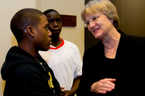 Crimson Summer Academy student Regal Sealy, 15, asks President Drew Faust a question about her research on the Civil War. Sealy said he hopes Faust remembers him when he applies to Harvard in 2012.