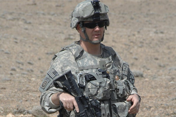 Army Maj. Kit Parker on a mission in Afghanistan. Parker, an engineer at Harvard's School of Engineering and Applied Sciences, is working with the 10th Mountain Division to improve how the Army carries out its evolving mission there.