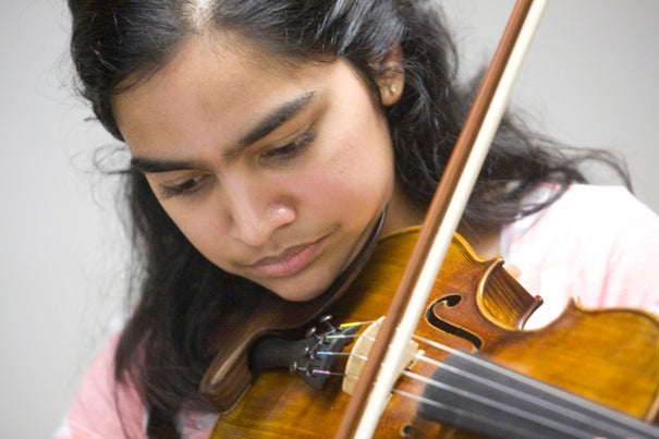 Holly Hajare rehearses for the Summer School Orchestra inside the basement of Memorial Hall.