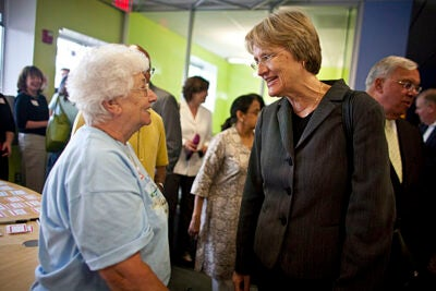 In June, Harvard President Drew Faust (center) and Mayor Thomas M. Menino (background) awarded the first round of Harvard Allston Partnership Grants. Faust chats with Allston resident Rita DiGesse (left) at the summer ceremony. Applications are now being accepted for the second round of grants.