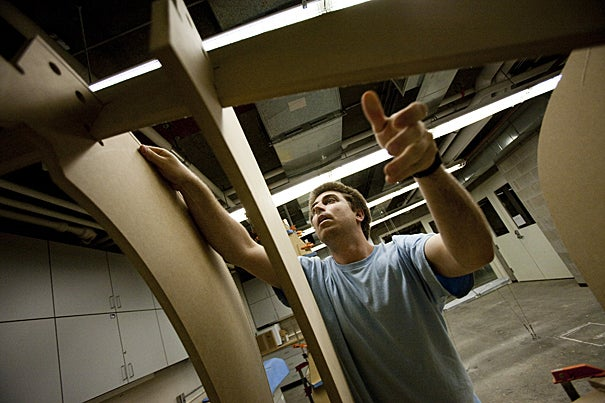 GSD student Julian-Bushmann Copp works in a woodworking area in Gund Hall. He is one of many GSD students helping to re-create a  library in Boston's Chinatown.