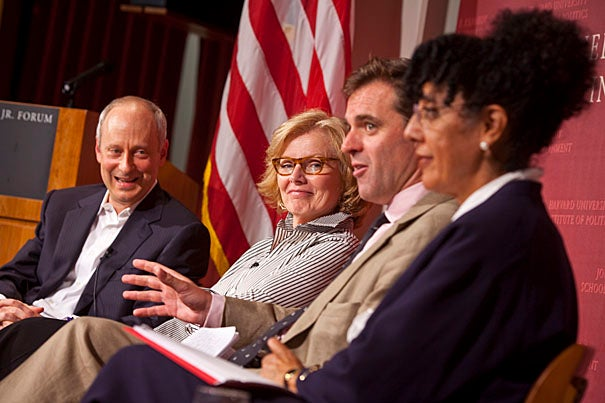 "The evening panel was the first public discussion of Michael Sandel's latest book, ""Justice: What's the Right Thing to Do?"" Sandel, the Anne T. and Robert M. Bass Professor of Government (from left), was joined by author, columnist, and speechwriter Peggy Noonan, who this fall is a fellow at the Institute of Politics, which sponsored the panel; Niall Ferguson, Laurence A. Tisch Professor of History, and the William Ziegler Professor of Business Administration at Harvard Business School; and Lani Guinier, Bennett Boskey Professor of Law at Harvard Law School."