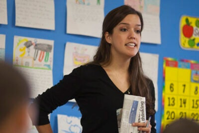 Teach For America corps member Gaby Barahona works with students at the John M. Tobin School in Cambridge, Mass.