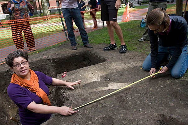"Associate Curator Diana Loren (left) and Senior Curatorial Assistant Christina Hodge at the dig site in front of Matthews Hall where ""The Archaeology of Harvard Yard"" class continues its work uncovering the College's roots."