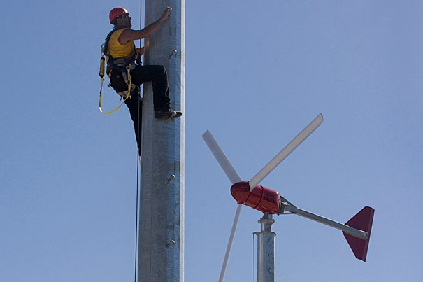 Thomas Dowd, owner of North Shore Solar and Wind Power, installs one of the twin turbines on top of Harvard's Soldiers Field Parking Garage. Each turbine is rated at 10 kilowatt-hours, which represent the University's largest wind energy project on campus to date.