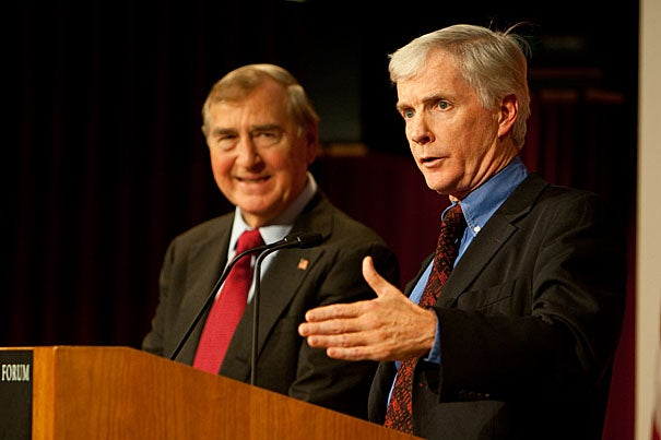Belfer Center Director Graham Allison (left) listens as retired diplomat Ryan C. Crocker tells the Harvard Kennedy School audience that when U.S. foreign policy falters it is often from a failure to understand geography and history.