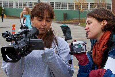 Student Sarah Ahmedi (left) films a short sequence as Briget Ganske, a student at Harvard Graduate School of Education, assists.