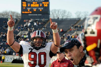 Harvard fullback Kyle Juszczyk '13 rejoices while Crimson head coach Tim Murphy is doused with ice-cold Gatorade. The two were celebrating the Crimson's 14-10 victory over Yale in the 126th playing of The Game.