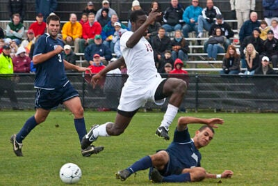 Kwaku Nyamekye '10 (center) takes the high road over a competitor as the Harvard men's soccer team scores twice in the second half to defeat Monmouth, 3-0.