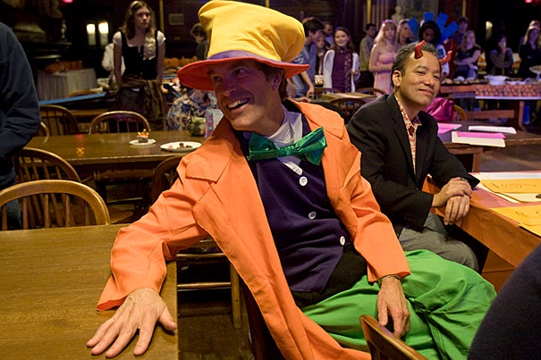 Thomas A. Dingman (left), dean of freshmen and Mad Hatter for the night, enjoys the Catwalk with Robert A. Lue, professor of the practice of molecular and cellular biology and director of Life Sciences Education.
