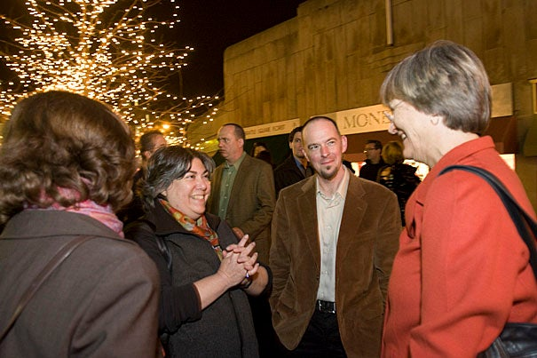 """Cambridge Historical Society President Jinny Nathan (second from left) and its  executive director, Gavin Kleespies (center), chat with Harvard President Drew Faust during the """"Think Harvard Square"""" festivities."""