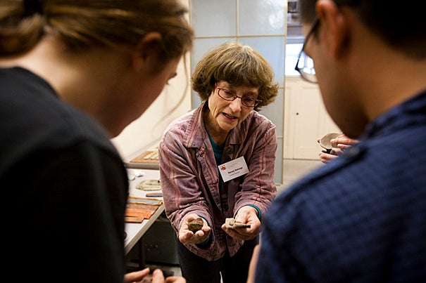 Longtime director Nancy Selvage (center) is the driving force behind the program and its integrated curriculum that taps into art and scholarship across the University and around the world. Here she introduces undergraduates to ceramics.