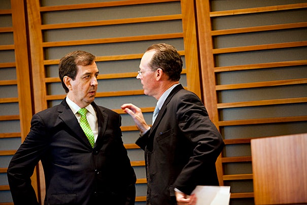 Jaime Sepulveda (left), former director of Mexico's National Institutes, talks to Paul Farmer, chair of Harvard Medical School's Department of Global Health and Social Medicine. In his introductory remarks, Farmer said that global health is not a discipline, but rather a set of worldwide problems that require several disciplines to address.