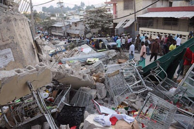 Harvard is extending medical and humanitarian aid to Haiti, which experienced a 7.0-magnitude earthquake, the largest ever recorded in the area, on Tuesday (Jan. 12). Debris from a collapsed building covers Delmas Road, a major thoroughfare, in Port-au-Prince.