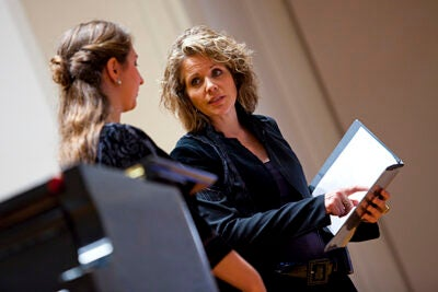 Renowned soprano Renée Fleming (right) challenged Sofia Selowsky '12, a mezzo-soprano with a deep register, to explore her voice's higher range. Fleming was teaching a master class through the Office for the Arts' Learning From Performers program.