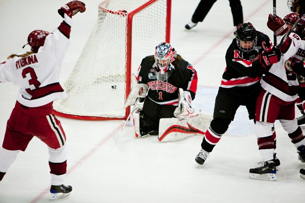 Liza Ryabkina '11 (left, #3 ) scored the first and only goal in the second period for the Crimson as they beat Northeastern, 1-0,  in the final round of the Beanpot at Bright Hockey Arena.
