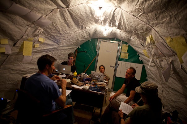 A field hospital in Fond Parisien, Haiti, was started less than a week after the earthquake hit on Jan. 12. Meeting inside a makeshift office are doctors from around the country, including (from left) Michael VanRooyen (Harvard), Hilarie Cranmer (Harvard), Jennifer Chan (University of Chicago), Christian Theodosis (University of Chicago), and Emille Calvello (Johns Hopkins).
