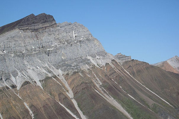 In this photo from Canada's Yukon Territory, an iron-rich layer of 716.5-million-year-old glacial deposits (maroon in color) is seen atop an older carbonate reef (gray in color) that formed in the tropics.