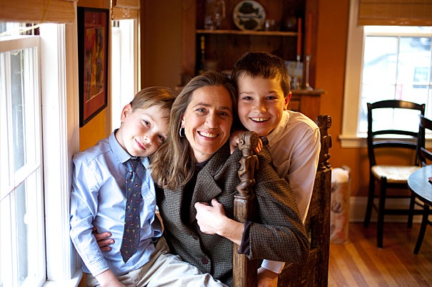 Harvard history professor Caroline Elkins balances her intense academic life with family life. Here she is with sons Jake, 7, and Andy, 9, in their Cambridge home.